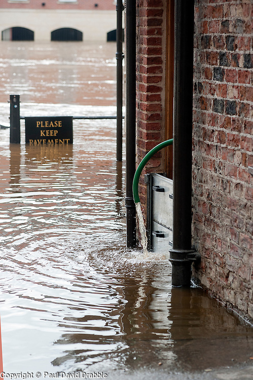 The Kings Arms Pub pumping out water On the day the environment Agency announce there is no longer a drought in Yorkshire, this is the view from the Kings street York looking across the river Ouse toward Queen Staith where river has risen flooding local roads and businesses after the wettest April since records began. .11  May 2012.Image © Paul David Drabble