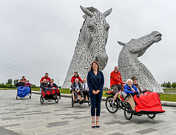 Pictured: Public health and sport minister Aileen Campbell with Cycling Without Age volunteers and users.<br /> <br /> Public health and sport minister Aileen Campbell took to the saddle to launch the Scotland-wide rollout of the Cycling without Age service, designed to get older people out and about.<br /> <br /> © Dave Johnston / EEm