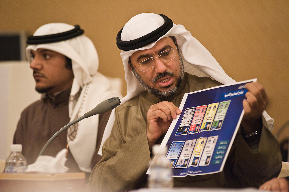 The Chairman of the Board of the Kuwait Transparency Society, Dr. Salah Mohammad Al-Ghazali (R), holding some elections-related items during a meeting with volunteers in Kuwait City. About 30 international observers, mostly from the Arab Network for Election Democracy, will monitor the election, along with 300 local volunteers.  About 30 international observers and 300 local volunteers will monitor the election in which more than 400,000 Kuwaiti men and women are eligible to vote to elect a new 50-member National Assembly (parliament).