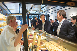 """© Licensed to London News Pictures. 13/04/2015. Carshalton, UK. Nick Clegg (L) and Tom Brake talk to staff at """"Bakery"""" on Carshalton High Street. Leader of the Liberal Democrats and Deputy Prime Minister Nick Clegg visits Carshalton and Wallington constituency on Monday (13th April) with Lib Dem candidate Tom Brake.  Photo credit : Stephen Simpson/LNP"""