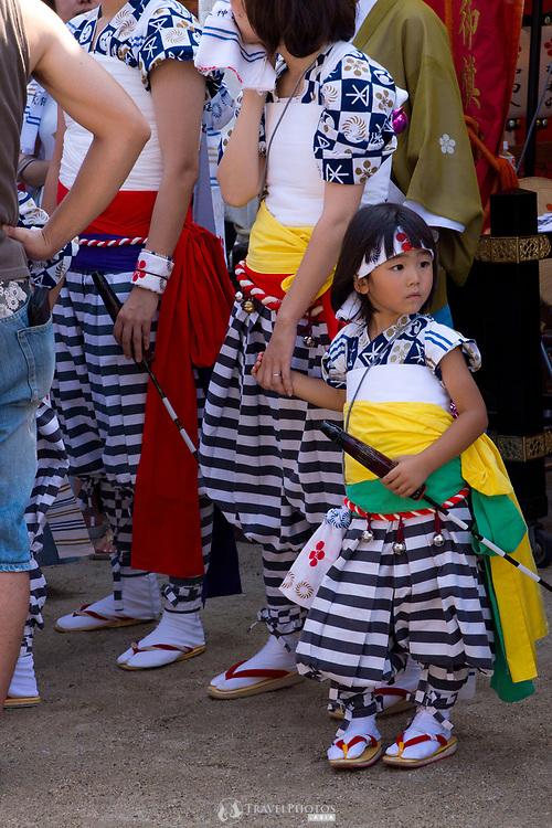 Mother and daughter preparing ahead of the Tenjin Festival (Tenjin Matsuri) in Osaka.