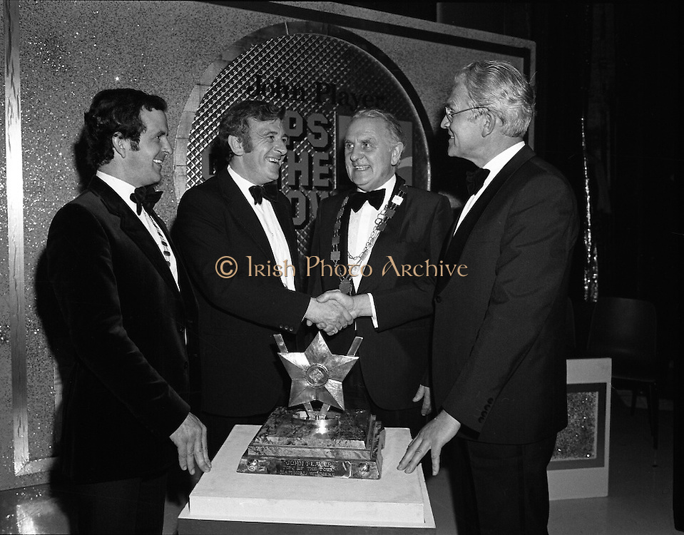 "Tops of the Town Final.   (N79)..1981..31.05.1981..05.31.1981..31st May 1981..The John Player sponsored Tops Of The Town competition had its final tonight in the Gaiety Theatre, Dublin.The overall winners were the Limerick Insurances Group...Image shows Mr Oliver Casey (right),Managing Director,John Player presenting the john Player ""Tops of the Town Award'to the producer of the winning Limerick Insurances group, Mr Douglas Howell. Included in the photograph are Mr Sam McCrum,(left), President of the Insurance Institute of Limerick and Clr Clem Casey, Lord Mayor of Limerick."