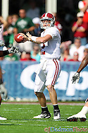 Alabama Crimson Tide quarterback Greg McElroy (12) drops back to pass against the Spartans in the Capital One bowl. Alabama leads at halftime 28-0.