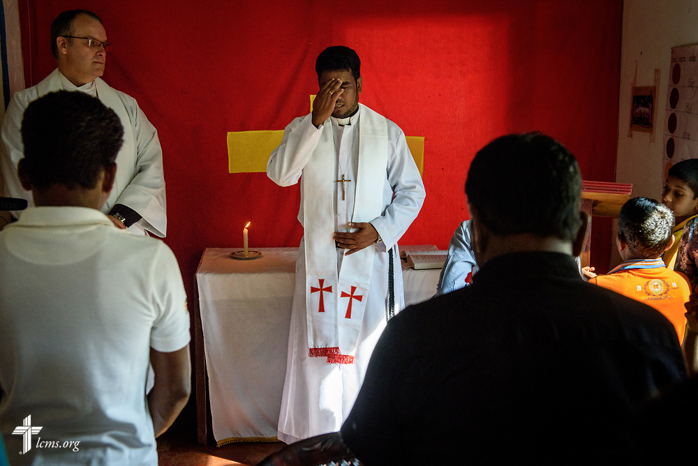 The Rev. P. Gnanakumar leads worship at the Eila rubber plantation in the Sabaragamuwa Province of Sri Lanka on Sunday, Jan. 21, 2018.  Next to him is the Rev. Steven Mahlburg, LCMS career missionary to Sri Lanka. LCMS Communications/ Erik M. Lunsford