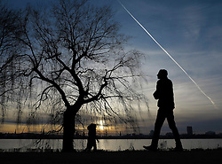 GERMANY HAMBURG 31DEC13 - A walker is silhouetted as he strolls around the Aussenalster in Hamburg prior to New Year's Eve.<br /> <br /> <br /> <br /> jre/Photo by Jiri Rezac<br /> <br /> <br /> <br /> © Jiri Rezac 2013