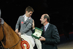 Sato Eiken (JPN) - Cartoon Z receiving the Rolex watch from Mr. <br /> Winner Rolex Fei World Cup Qualifier<br /> CSI-W Mechelen 2009<br /> Photo © Dirk Caremans