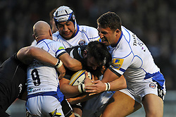 Chris York of Newcastle Falcons is tackled by Peter Stringer, Leroy Houston and Sam Burgess of Bath Rugby - Photo mandatory by-line: Patrick Khachfe/JMP - Mobile: 07966 386802 10/04/2015 - SPORT - RUGBY UNION - Newcastle upon Tyne - Kingston Park - Newcastle Falcons v Bath Rugby - Aviva Premiership