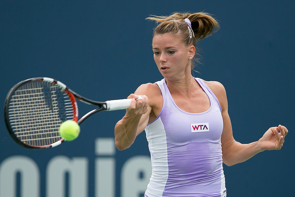 August 22, 2014, New Haven, CT:<br /> Camila Giorgi hits a forehand during the semi-final match against Magdalena Rybarikova on day eight of the 2014 Connecticut Open at the Yale University Tennis Center in New Haven, Connecticut Friday, August 22, 2014.<br /> (Photo by Billie Weiss/Connecticut Open)
