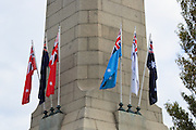 Flags flying on Cenotaph during 2007 ANZAC day parade service in Hobart Tasmania <br />