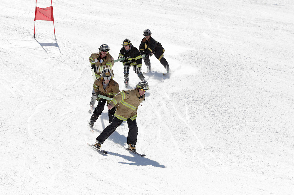 Bridgeville, New York - A team of Rock Hill firefighters heads down a course while carrying a fire hose at Holiday Mountain during the firemen's races on March 6, 2010.