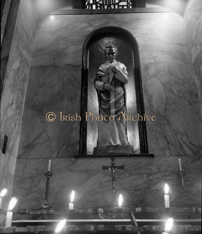St Valentine's Shrine, Whitefriar Street.   K88.1977..11.02.1977..02.11.1977..11th February 1977..St Valentine was a priest who lived in Rome in the Third Century AD. After assisting Christian martyrs who were persecuted  by the Emperor Claudius he was taken prisoner in 269 AD. Refusing to renounce his faith he was executed ,by beheading, on 14th February 290 AD..In 1835 at the direction of pope Gregory XVI his remains were disinterred and presented to Father John Spratt, Master of Theology within the Carmelite Order. A shrine was erected in the Carmelite Church in Whitefriar Street to house the remains and is still there to this day..St Valentine now regarded as the patron saint of lovers and is celebrated every year on 14th February..Image of the shrine in Whitefriar Street containing the remains of St Valentine, also included is a small vessel tinged with his blood.