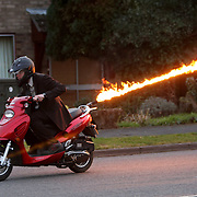 "COLIN FURZE ON HIS FLAME THROWING MOPED... A plumber who adapted his scooter to fire 15ft flames from the rear has been given a police caution following his arrest for an alleged firearms offence....Colin Furze, 30, spent a month modifying his moped with an anti-tailgating flame thrower operated by the flick of a switch...He displayed his James Bond-style scooter, which can travel up to 60mph in the worldwide press two months ago...But Lincolnshire Police spotted the pictures of Mr Furze allegedly riding his scooter on a public highway and arrested him...He was held on suspicion of possessing an object converted into a firearm, and was released on unconditional police bail without charge...When Mr Furze, of Stamford, Lincs, returned to answer bail yesterday (Thurs) he was given a police caution...""I'm relieved it's all over,"" he said today (Fri)...SEE COPY CATCHLINE Flame thrower man cautioned"