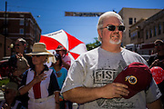 30 JUNE 2012 - PRESCOTT, AZ:   A man places his hand over his heart as the flag is carried past him at the Prescott Frontier Days Rodeo Parade. The parade is marking its 125th year. It is one of the largest 4th of July Parades in Arizona. Prescott, about 100 miles north of Phoenix, was the first territorial capital of Arizona.   PHOTO BY JACK KURTZ