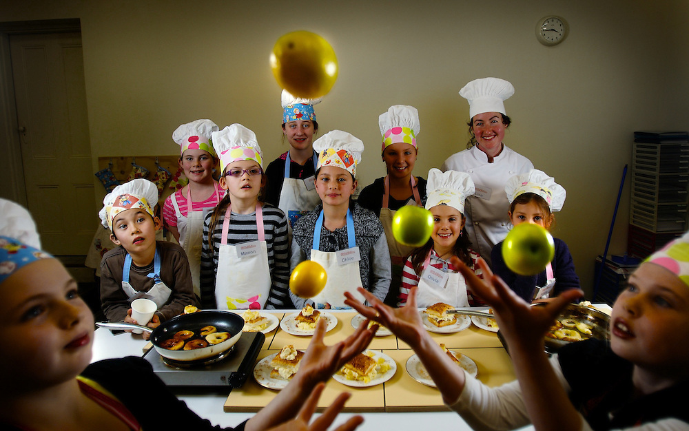 Alexandra Brooks, 9, (left) and Brittany Mills, 10, with other young Masterchefs at a Little Kitchen cooking class in North Fitzroy...Alexandra 9yrs and Brittany 10yrs entertain these little chefs at Little Kitchen in Nth Fitzroy where kids learn to cook Pic By Craig Sillitoe  10/07/2009 SPECIAL 000  Pic By Craig Sillitoe CSZ / The Sunday Age melbourne photographers, commercial photographers, industrial photographers, corporate photographer, architectural photographers, This photograph can be used for non commercial uses with attribution. Credit: Craig Sillitoe Photography / http://www.csillitoe.com<br />