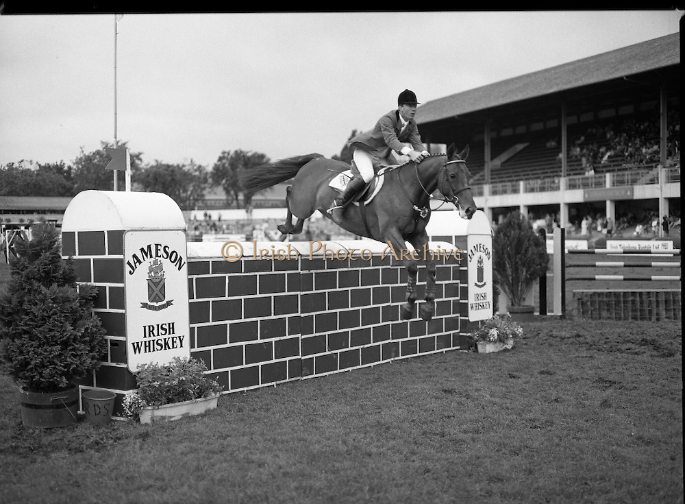 Jameson Whiskey International at the Dublin Horse Show.  (R39).1986..07.08.1986..08.07.1986..7th August 1986..The Jameson Whiskey International at the Dublin Horse Show in the RDS was won by Peter Charles of Great Britain. He rode 'Merrimandias' to victory in the event...Image shows Michael Whitaker (GB) in the Jameson Whiskey International clearing the wall aboard his mount 'Next Courtway' at the Horse Show. Jameson's, Irish, Whiskey, jameson,
