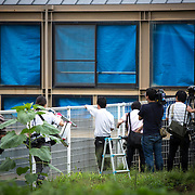 SAGAMIHARA, JAPAN - JULY 27 :  Japanese media shooting the window of a murder area in Tsukui Yamayuri-en building at Sagamihara on Wednesday, July 27, 2016 in Kanagawa prefecture, Japan. Police arrested 26 year old Satoshi Uematsu after breaking inside the building facility for handicapped and killing 19 people and injuring 20 in the city of Sagamihara, west of Tokyo. (Photo: Richard Atrero de Guzman/NURPhoto)