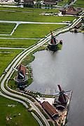 Nederland, Amsterdam, Zaandam, 25-05-2010. Molens aan oevers van rivier de Zaan, onderdeel van de Zaanse Schans. .Mills on the banks of the river Zaan, part of the Zaanse Schans..luchtfoto (toeslag), aerial photo (additional fee required).foto/photo Siebe Swart