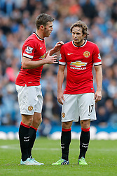 Michael Carrick talks to Daley Blind of Manchester United - Photo mandatory by-line: Rogan Thomson/JMP - 07966 386802 - 02/11/2014 - SPORT - FOOTBALL - Manchester, England - Etihad Stadium - Manchester City v Manchester United - Barclays Premier League.