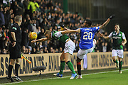 Ryan Porteous tangles with Alfredo Morelos during the Ladbrokes Scottish Premiership match between Hibernian and Rangers at Easter Road, Edinburgh, Scotland on 19 December 2018.