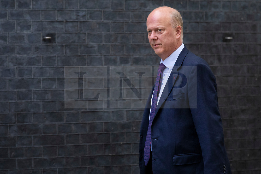 © Licensed to London News Pictures. 10/07/2018. London, UK. Transport Secretary Chris Grayling arrives on Downing Street for the Cabinet meeting. Photo credit: Rob Pinney/LNP