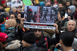 Protest gegen Abschiebungen nach Afghanistan. Hunderte ¸berwiegend afghanische Fluechtlinge protestierten in Berlin fuer Bleiberecht und gegen die Eingruppierung verschiedener Bezirke des Kriegslandes als sichere Regionen. / 101216 ***<br /> Protest against deportations to Afghanistan. Hundreds of mostly Afghan refugees protest in Berlin for the right to stay and against the determine various districts of the war country as safe regions. <br /> Berlin, Germany - 10.12.2016