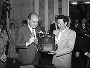 Vietnamese Refugees are Naturalised.  (R61)..1987..08.07.1987..07.08.1987..8th July 1987..A large group of Vietnamese refugees were presented with certificates of naturalisation by Justice Minister, Gerard CollinsTD at the dept of Foreign Affairs in Iveagh House today. The vietnamese were dispossed due to the Vietnam war.The group ,consisting of 156 adults, arrived in Ireland from Vietnam and some refugee camps inHong Kong and Malaysia...Image shows Minister Gerard Collins presenting the certificates of naturalisation to the Vietnamese adults in Iveagh House, Dublin. Minister Collins accepts a plaque of appreciation from the newly naturalised Irish citizens. The plaque was to thank the Irish people for the humanity extended to them since their arrival in Ireland.