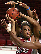 (110705-Amherst, MA) UMass Amherst's Rashaun Freeman, #1, grabs a rebound as his teammates also reach for the ball during practice.