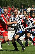 21.07.2007, Pietarsaari, Finland..Veikkausliiga 2007 - Finnish League 2007.FF Jaro - Vaasan Palloseura.Joonas Ik?l?inen (VPS) v Jonas Portin (Jaro).©Juha Tamminen.....ARK:k