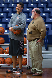 UPike Men's head basketball coach Kelly Wells, right, talks with longtime UPike Athletics supporter Charlie Pinson, right, during team workouts, Wednesday, Sept. 24, 2014 at the Eastern Kentucky Expo Center in Pikeville. <br /> <br /> Photo by Jonathan Palmer, Special to the CJ