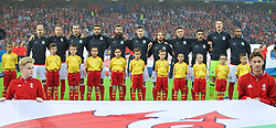 LILLE, FRANCE - Friday, July 1, 2016: Wales players sing the national anthem before the UEFA Euro 2016 Championship Quarter-Final match against Belgium at the Stade Pierre Mauroy. Aaron Ramsey, Chris Gunter, Gareth Bale, Hal Robson-Kanu, Joe Ledley, Ben Davies, Joe Allen, James Chester, Neil Taylor, goalkeeper Wayne Hennessey, captain Ashley Williams. (Pic by David Rawcliffe/Propaganda)