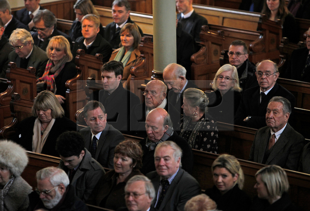 © Licensed to London News Pictures. 18/01/2013. London, U.K..Sir Sterling (centre) Moss and Martin Brundle at the Memorial service for Professor Sid Watkins, former FIA Formula One medical delegate, and crusader for motor sport safety, midday today (18/1/2013) at St.Marylebone Parish Church..Photo credit : Rich Bowen/LNP