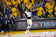 Golden State Warriors forward Draymond Green (23) celebrates on the sidelines during Game 2 of the NBA Finals against the Cleveland Cavaliers at Oracle Arena in Oakland, Calif., on June 4, 2017. (Stan Olszewski/Special to S.F. Examiner)