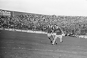 Tipperary runs down the field chased by Kilkenny who has his hurl ready for the attack during the All Ireland Minor Hurling Final, Tipperary v Kilkenny in Croke Park on the 5th September 1976.