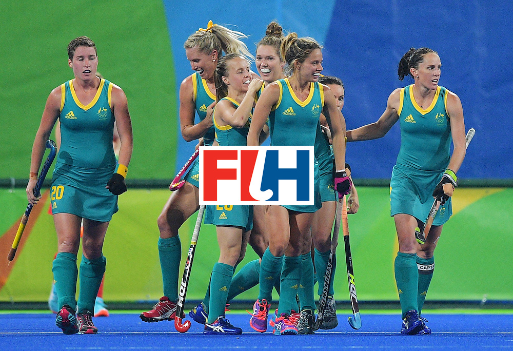 Australia players celebrate a goal during the women's field hockey Britain vs Australia match of the Rio 2016 Olympics Games at the Olympic Hockey Centre in Rio de Janeiro on August, 6 2016. / AFP / Carl DE SOUZA        (Photo credit should read CARL DE SOUZA/AFP/Getty Images)