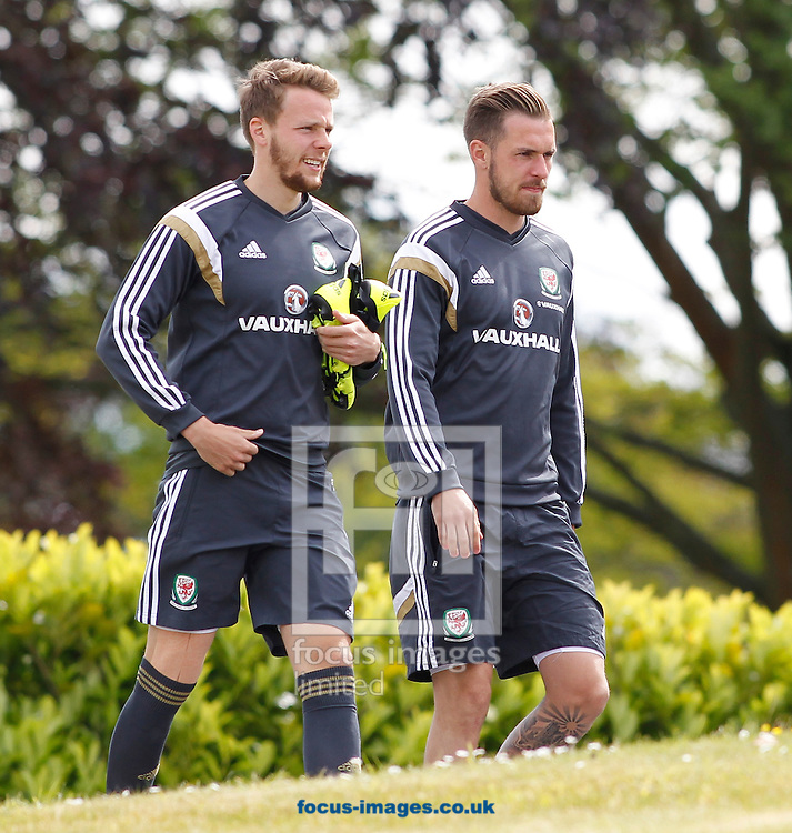 Chris Gunter (L) and Aaron Ramsey (R) arriving for the Wales Training session at the Vale Resort, Hensol<br /> Picture by Mike Griffiths/Focus Images Ltd +44 7766 223933<br /> 08/06/2015