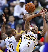 March 14, 2012; Indianapolis, IN, USA; Indiana Pacers power forward David West (21) and Indiana Pacers shooting guard George Hill (3) battle for a rebound against the Philadelphia 76ers at Bankers Life Fieldhouse. Indiana defeated Philadelphia 111-94. Mandatory credit: Michael Hickey-US PRESSWIRE