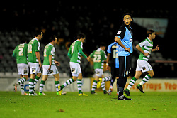 Wycombe Wanderers' Charles Dunne glands back as the Yeovil Town team celebrate their goal behind him - Photo mandatory by-line: Dougie Allward/JMP  - Tel: Mobile:07966 386802 04/12/2012 - SPORT - FOOTBALL - Johnstone's Paint Trophy  -  Yeovil  -  Huish Park  -  Yeovil Town V Wycombe Wanderers
