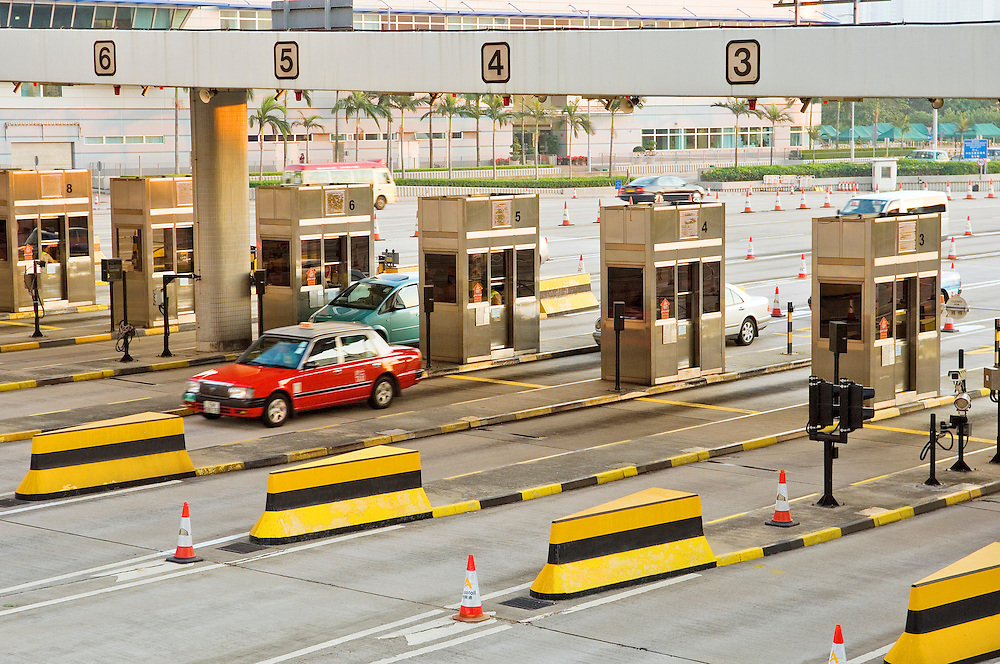 Highway toll booth kiosks at entrance to the Western Harbour Crossing road tunnel connecting Kowloon to Hong Kong Island. China