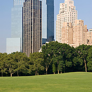 Manhattan skyline, including The Time Warner Center and Trump International Hotel & Tower, as seen from Sheep Meadow in Central Park, New York City, NY