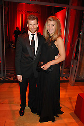 TOM & AMBER AIKENS at a dinner held at the Natural History Museum to celebrate the re-opening of their store at 175-177 New Bond Street, London on 17th October 2007.<br />