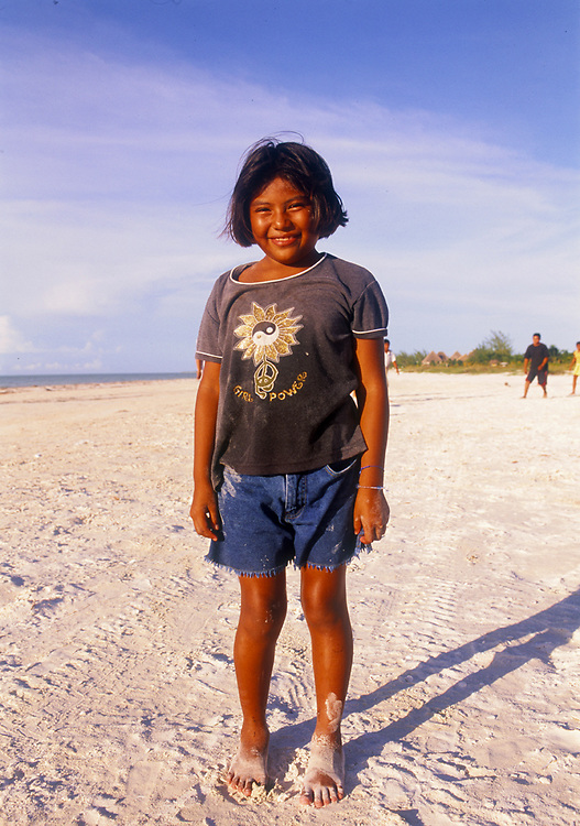 Local girl on the beach at Isla de Holbox, Mexico.