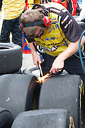 June 14, 2009: A pit crew member test the tire wear at the Life Lock 400 race, Michigan International Speedway, Brooklyn, MI.