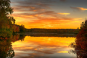 Autumn sunset with peak color on a lake in New Ipswich, NH, USA