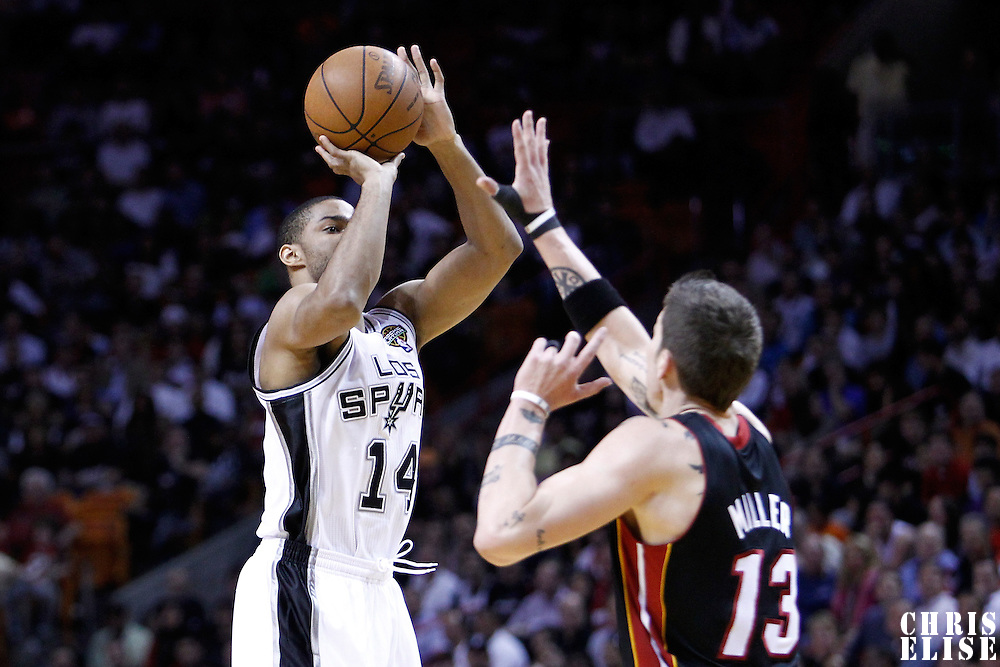 14 March 2011: San Antonio Spurs point guard Gary Neal (14) takes a jumpshot over Miami Heat shooting guard Mike Miller (13) during the Miami Heat 110-80 victory over the San Antonio Spurs at the AmericanAirlines Arena, Miami, Florida, USA.