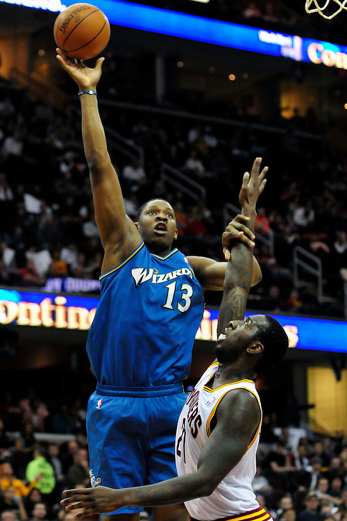 Feb. 13, 2011; Cleveland, OH, USA; Washington Wizards forward Kevin Seraphin (13) shoots over Cleveland Cavaliers power forward J.J. Hickson (21) during the third quarter at Quicken Loans Arena. The Wizards beat the Cavaliers 115-100 for their first win on the road this season. Mandatory Credit: Jason Miller-US PRESSWIRE