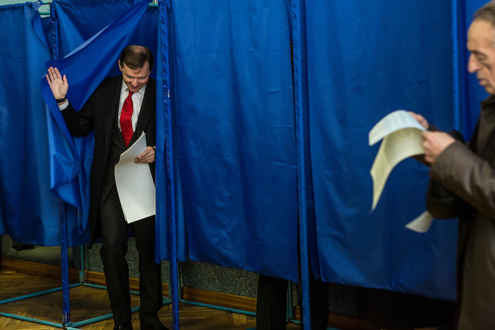 KIEV, UKRAINE - OCTOBER 26: Oleh Lyashko (L), head of Ukraine's Radical Party, emerges from a voting booth after casting his ballot at a polling station on October 26, 2014 in Kiev, Ukraine. The country's parliamentary elections are seen as key to President Petro Poroshenko's ability to advance his agenda. (Photo by Brendan Hoffman/Getty Images) *** Local Caption *** Oleh Lyashko