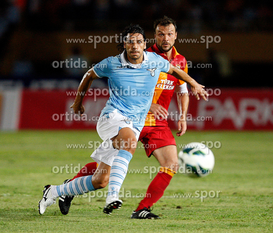 04.08.2012, Ataturk Stadium, Izmir, TUR, Testspiel, Galatasaray Istanbul vs Lazio, im Bild Alvaro Rafael Gonzalez Luengo of Lazio and Tomas Ujfalusi of Galatasaray.  during Friendly Match between Galatasaray Istanbul and Lazio at the Ataturk Stadium, Izmir, Turkey on 2012/08/04. EXPA Pictures © 2012, PhotoCredit: EXPA/ Seskimphoto/ Sphk/ ****** ATTENTION - for AUT, ESP, ITA, SWE, SLO, NOR, FIN, SRB NED and USA ONLY! *****