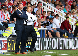 Peterborough United's manager Darren Ferguson and Swindon Town's manager Mark Cooper - Photo mandatory by-line: Joe Dent/JMP - Tel: Mobile: 07966 386802 03/08/2013 - SPORT - FOOTBALL -  London Road Stadium - Peterborough -  Peterborough United v Swindon Town - Sky Bet One