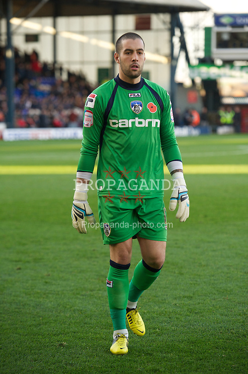 OLDHAM, ENGLAND - Saturday, November 10, 2012: Oldham Athletic's goalkeeper Dean Bouzanis in action against Tranmere Rovers during the Football League One match at Boundary Park. (Pic by David Rawcliffe/Propaganda)