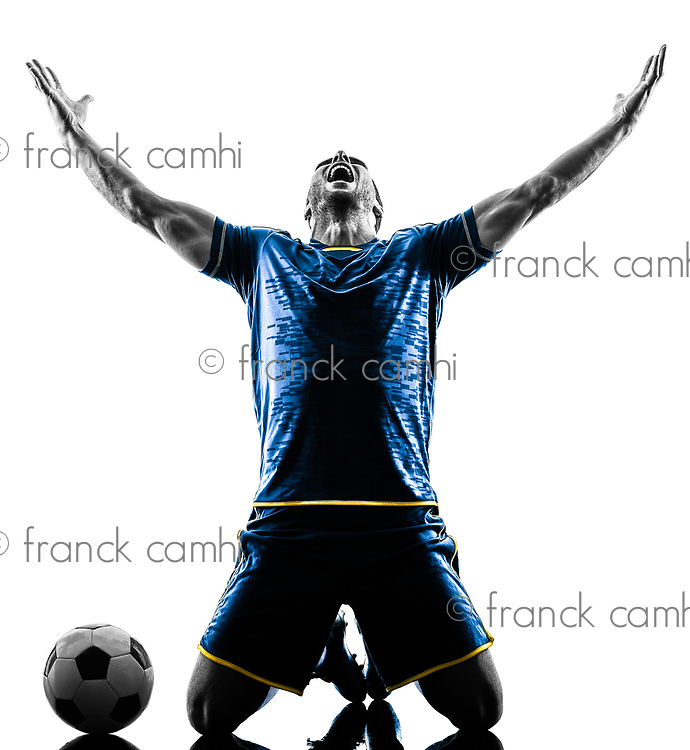 one caucasian soccer player man happy celebration  in silhouette isolated on white background